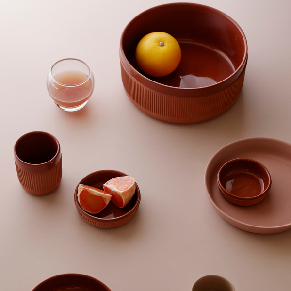 The Junto Bowl by Normann Copenhagen was inspired by traditional Spanish ceramics in a beautiful fired terracotta. We love the organic shape of the handmade stoneware, and the Junto Bowl is the perfect addition to a modern counter top or dining table.