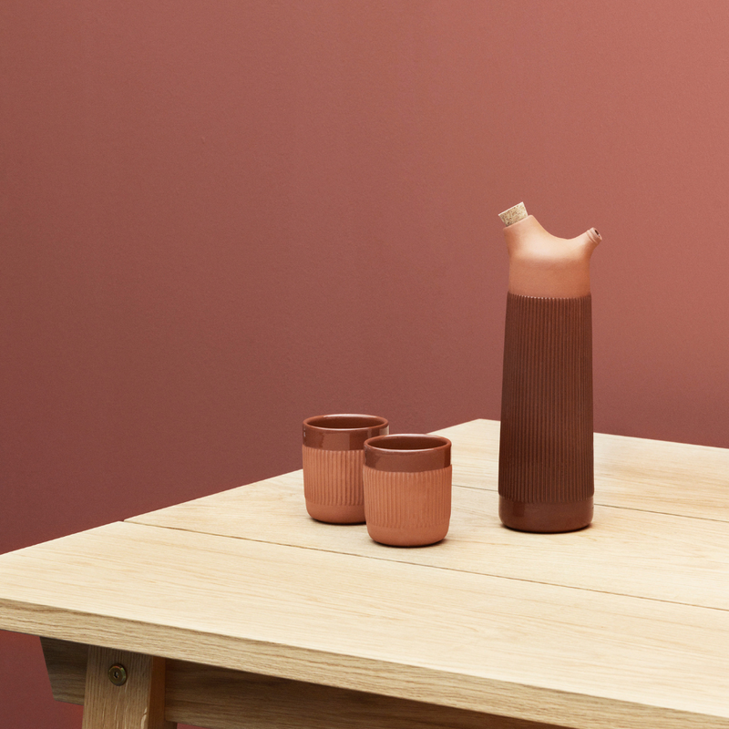 The Junto Carafe by Normann Copenhagen was inspired by traditional Spanish ceramics in a beautiful fired terracotta. We love the organic shape of the handmade stoneware, which creates the perfect spout for pouring water or juice from the carafe.