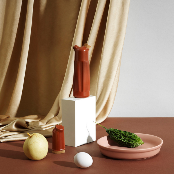 The Junto Oil Bottle by Normann Copenhagen was inspired by traditional Spanish ceramics in a beautiful fired terracotta. We love the organic shape of the handmade stoneware, which perfectly mimics the smooth pour of your favorite cooking oil.