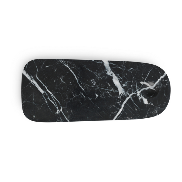 The Pebble Board in Small by Normann Copenhagen is the perfect addition to any home's kitchen decor. Made from a beautiful black marble with white and grey veining, the Pebble Board is a great way to serve up a selection of cheeses and other charcuterie, and it looks beautiful when styled with your most loved breakfast fruits and baked goods.