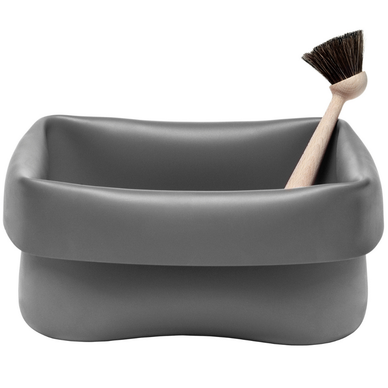 The Washing-up Bowl & Brush set by Normann Copenhagen is a fun and unique storage solution that can be used in a variety of places throughout the home.  The Washing-up Bowl is made of a rubber material, making it perfect for use in the kitchen or bathroom, but its durability is also suitable for holding your favorite plant, storing toys or chilling down your favorite beverages. We love that this item is portable and easy to care for.
