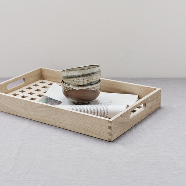 The Skagerak Fionia Tray is a modern, rectangular tray that can be used in a variety of spots throughout the home. We love it styled on a bed side table or bench at the base of a bed, but it can also be used when hosting guests outdoors or in the dining room. It's beautiful and simplistic, and will quickly become an item you use often.