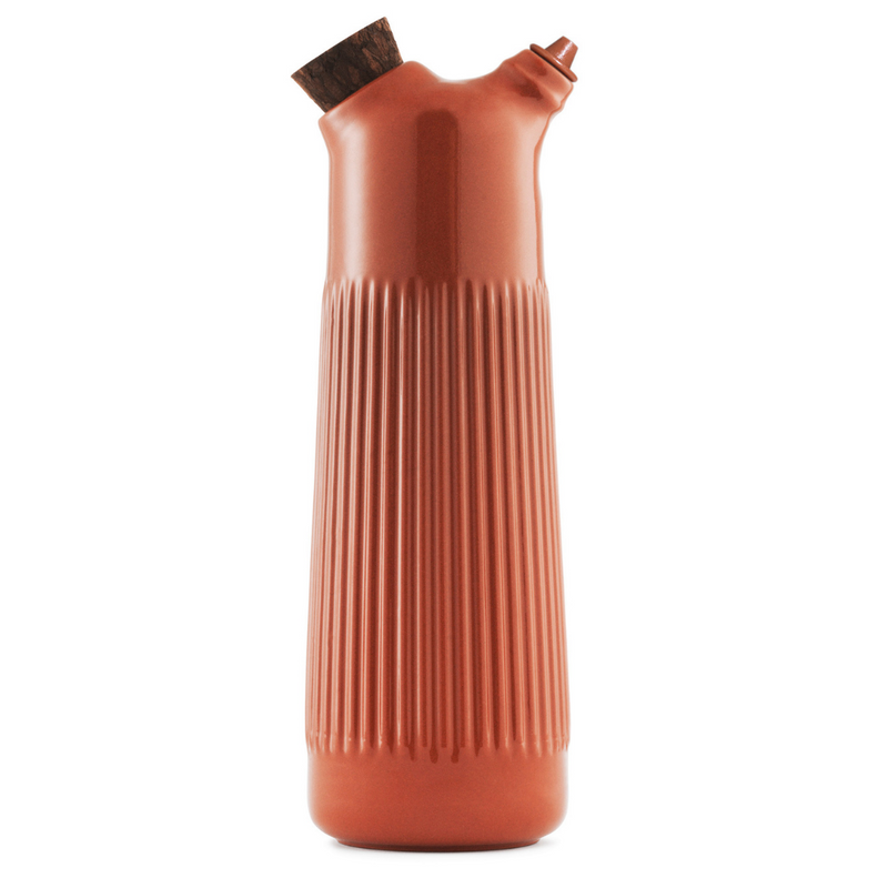 The Junto Vinegar Bottle by Normann Copenhagen was inspired by traditional Spanish ceramics in a beautiful fired terracotta. We love the organic shape of the handmade stoneware, which perfectly mimics the smooth pour of your favorite cooking vinegar or dressing.