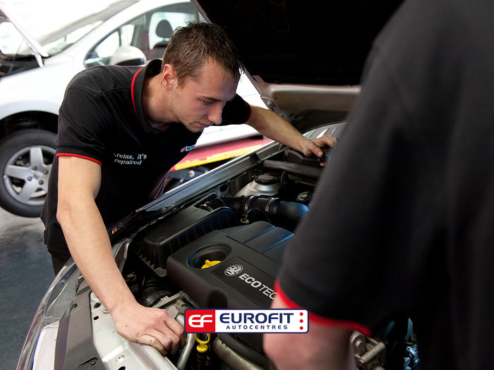 Eurofit Autocentres technician looking in car bonnet at engine