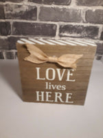"""Love Lives Here"" Painted Wooden Plaque Sign 6"" With Burlap Bow (M3)"