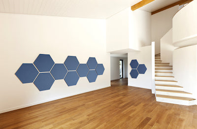 Hexagon acoustic panels mounted on a wall