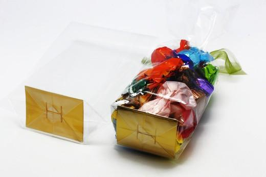 Clear poly bag with gold card - Medium