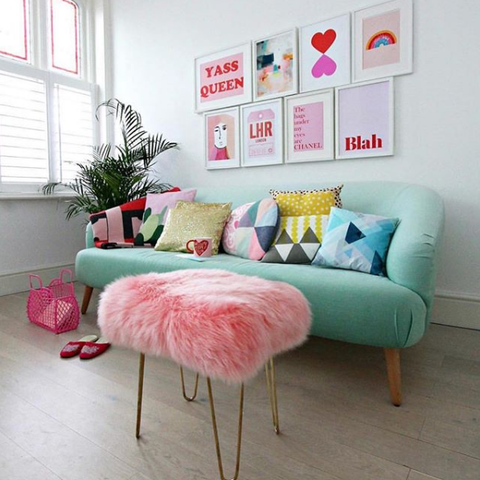 Candy Floss Pink Sheepskin Stool in a retro styled lounge in pastel and ice cream colours.