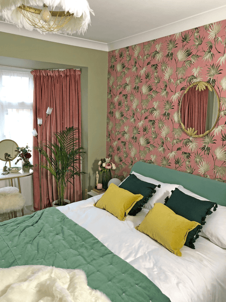 Bold pink and green floral wallpaper in an art deco inspired bedroom scheme.