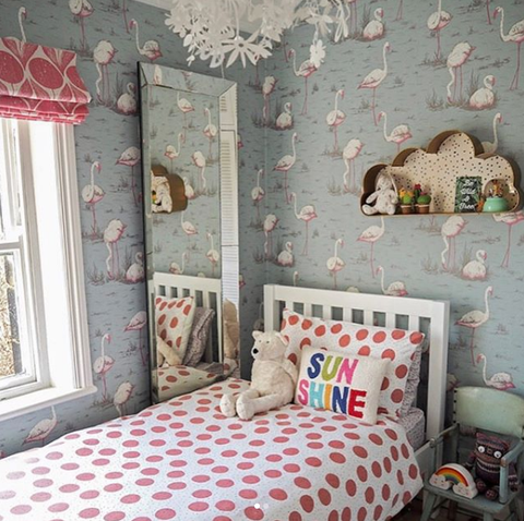 Pretty girls bedroom with flamingo wallpaper.