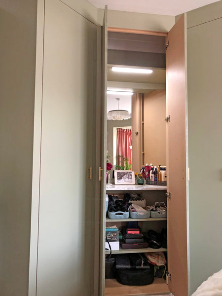 Bespoke fitted wardrobes with hidden dressible table and storage area.