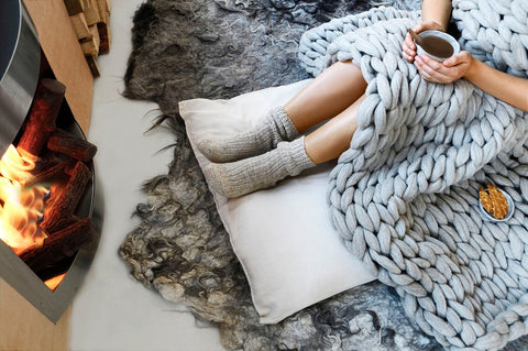 Chunky knit throw, roaring fire & hot chocolate