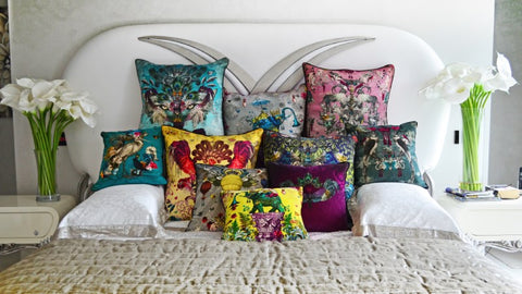 Santorus cushions on the bed.