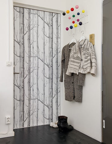 Door wallpapered with Wood wallpaper by Cole & Son.
