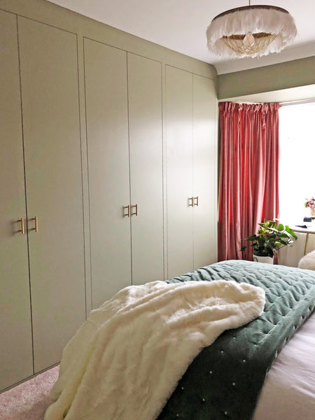Bespoke wardrobes painted in the same colour as the walls and woodwork.