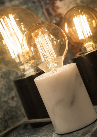 Close up view of black & white marble table lamps.