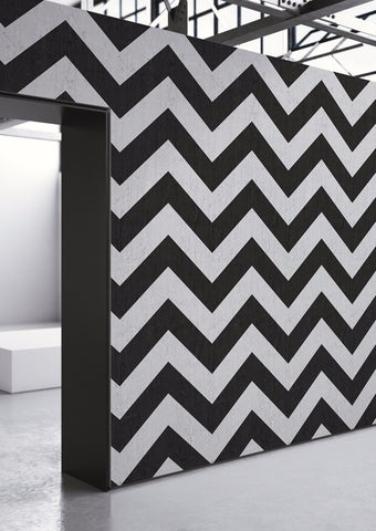 Herringbone wallpaper in black and white in a minimal setting.