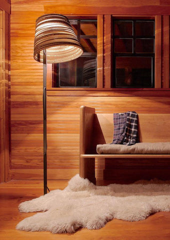 Warm glow given off a stylish floor lamp.
