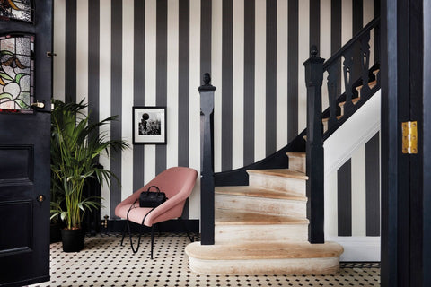 Black & white Jaspe Stripe Wallpaper in a hallway and up the staircase.