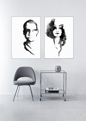 Black & white prints depicting a hand drawn portraits of a man and a woman.