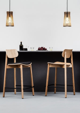 Oak Bar Stools at a black kitchen breakfast bar.