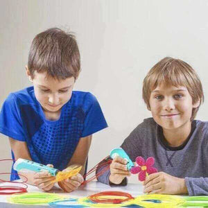 two boys drawing with 3d printing pens