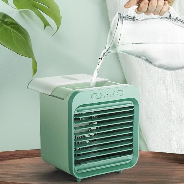 pouring water into rechargeable water-cooled air conditioner