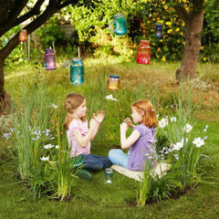 Girls playing in a garden fairy ring