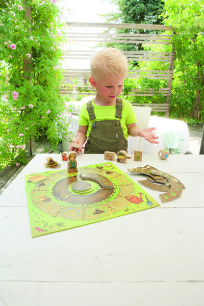 Child playing with HABA My Very First Games Little Garden
