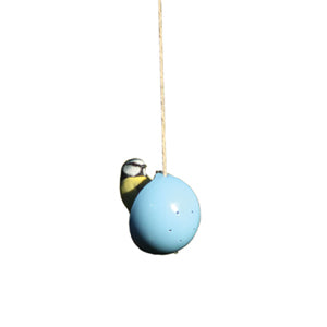 Bird eating from ashortwalk blue recycled plastic bird cake feeder