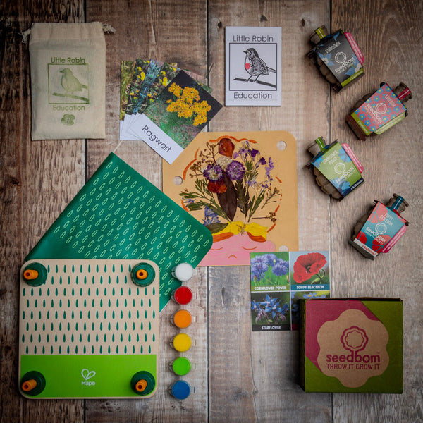 Layout of Wildflower Explorer gift set content including flower press, wildflowers flashcards and wildflower wonder seedbom box