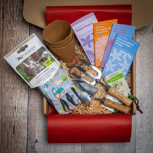 Young Gardener Starter Kit containing children's gardening tools, seeds, gloves and pots