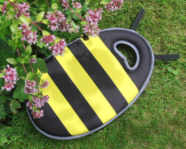 Kneelo® yellow and black stripey Buzz kneeler for children on grass
