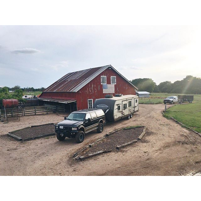 farm truck in front of a barn