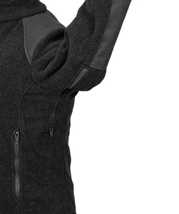 Zipper under sleeve of fire resistant jacket for ventilation.