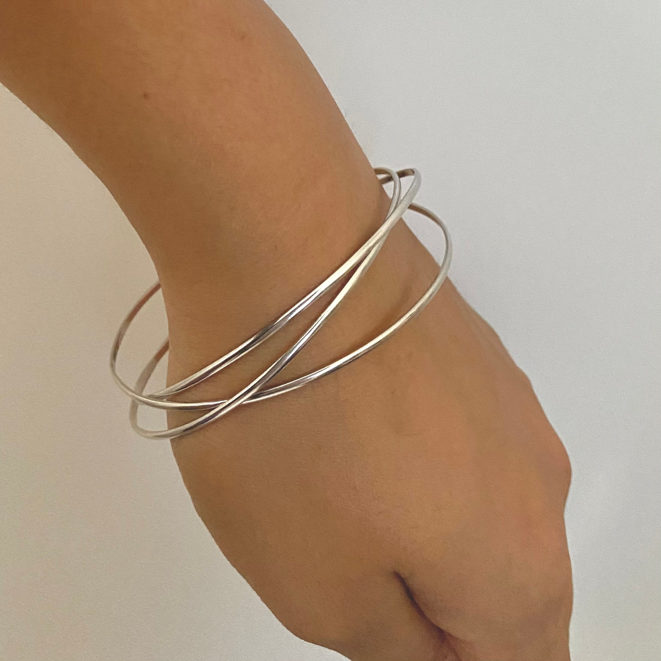 Intertwined Silver Bangle