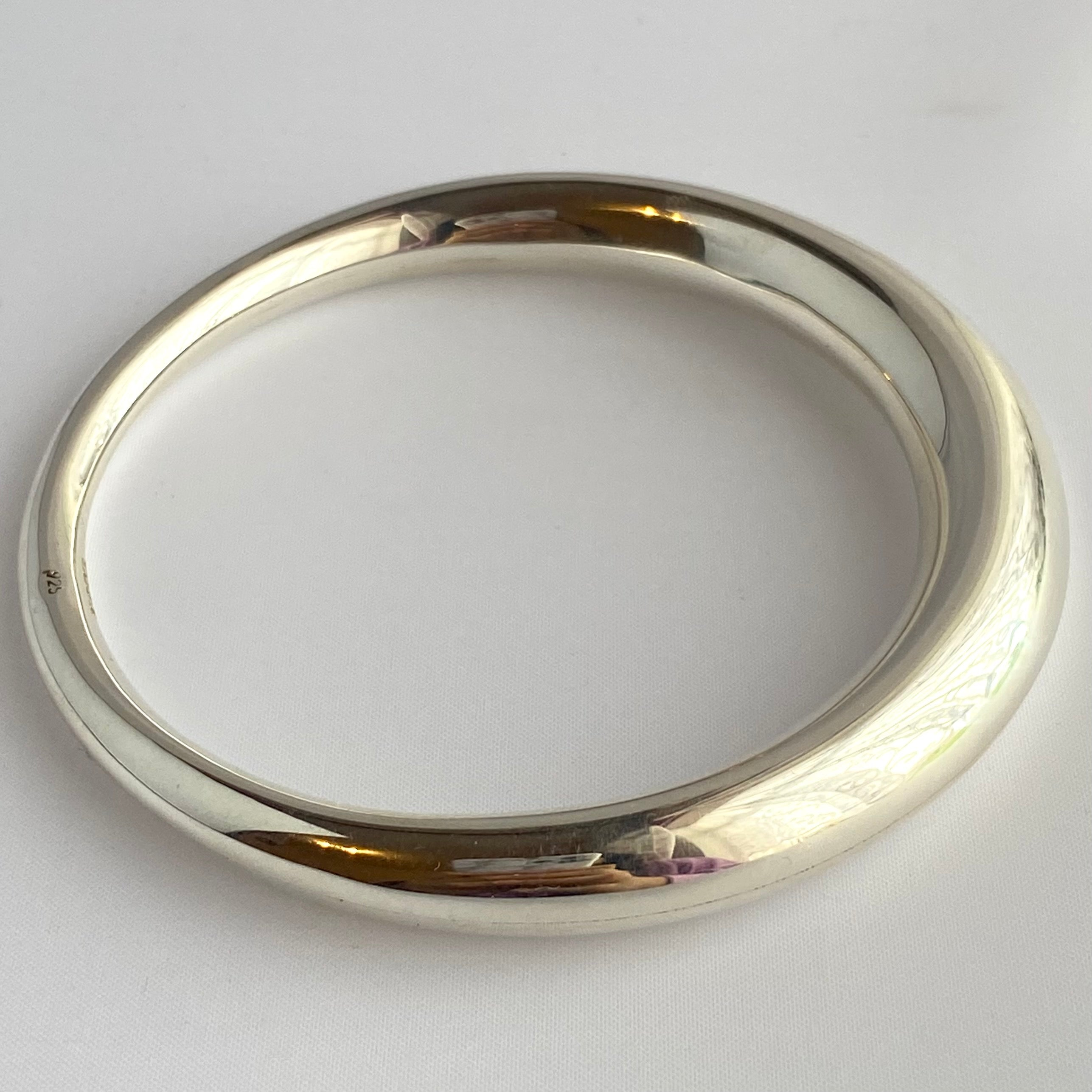 Chunky Silver Round Bangle with a Graduated Tapered Design