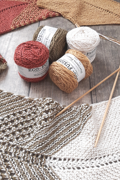 yarn and white and gray knitting pattern on table