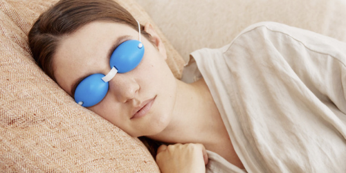 Blue EyeChill cooling eye mask on women laying down