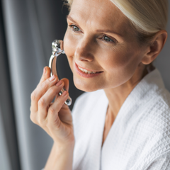 woman with silver facial messaging tool
