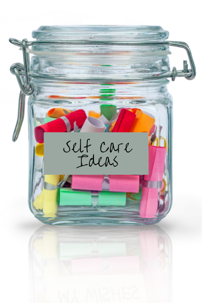 """glass jar with notes inside labeled """"self-care ideas"""""""