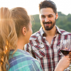 man and woman outside drinking wine