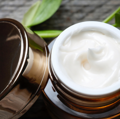 face moisturizer in canister on table