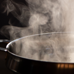boiling water in pot with steam