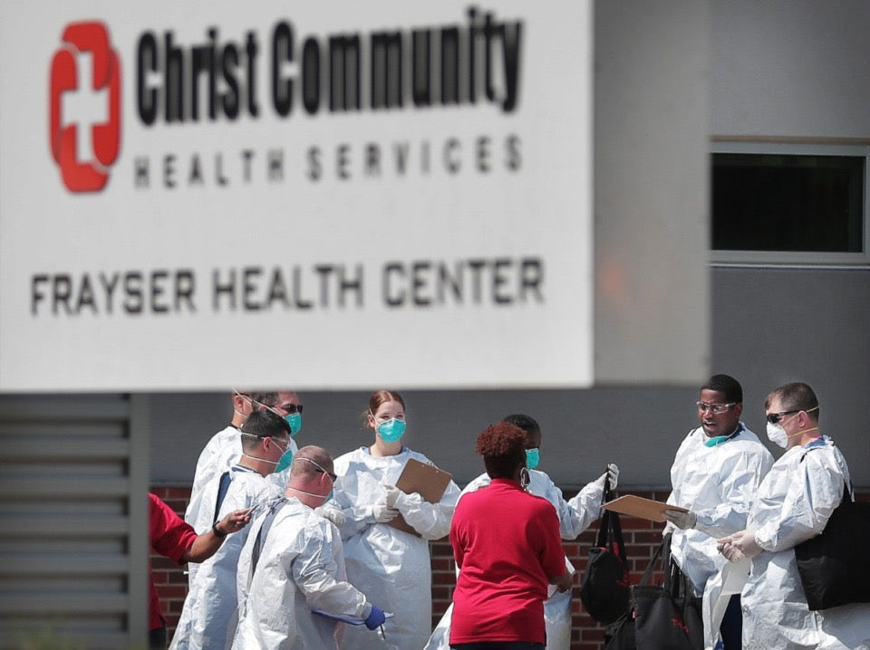 Christ Community staff, medical technicians and National Guard medics prepare to start a long day of COVID-19 testing as hundreds of Memphians line up at the Christ Community testing site in Frayser on April 25, 2020. (Jim Weber/Daily Memphian)