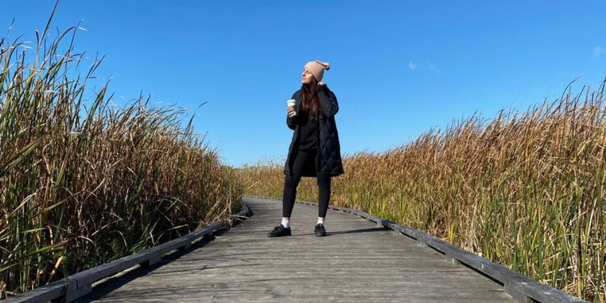 A woman enjoying the outdoors on a path