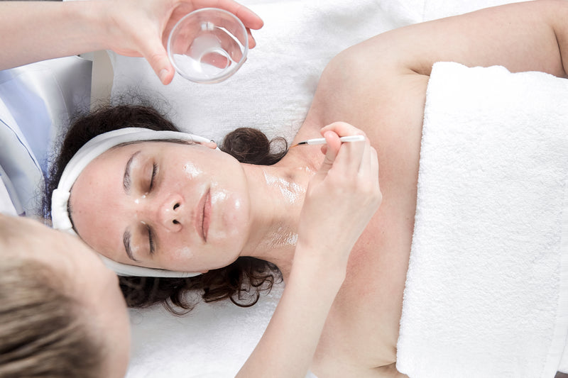 Girl getting Acne Facial