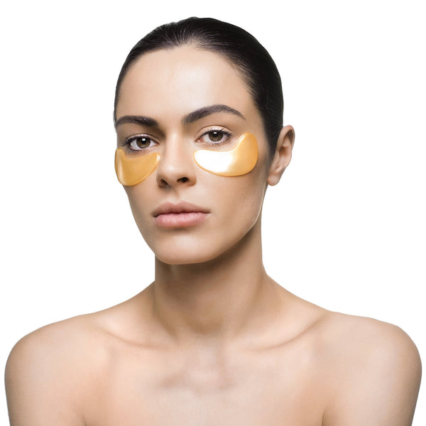 Woman with Knesko Skin Nano Gold Repair Collagen Eye Mask under her eyes