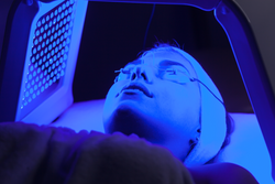 Girl getting Blue Light Therapy