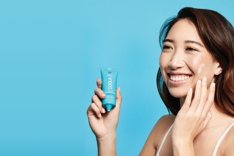 Girl applying Coola Suncare Classic Face Organic Sunscreen Lotion Spf 50